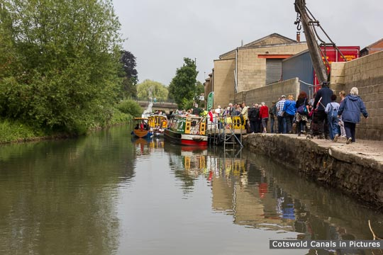 Boats and people at the Stroud-on-Water festival 2012.