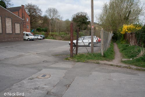 The site of the original lock is near the cars (right)