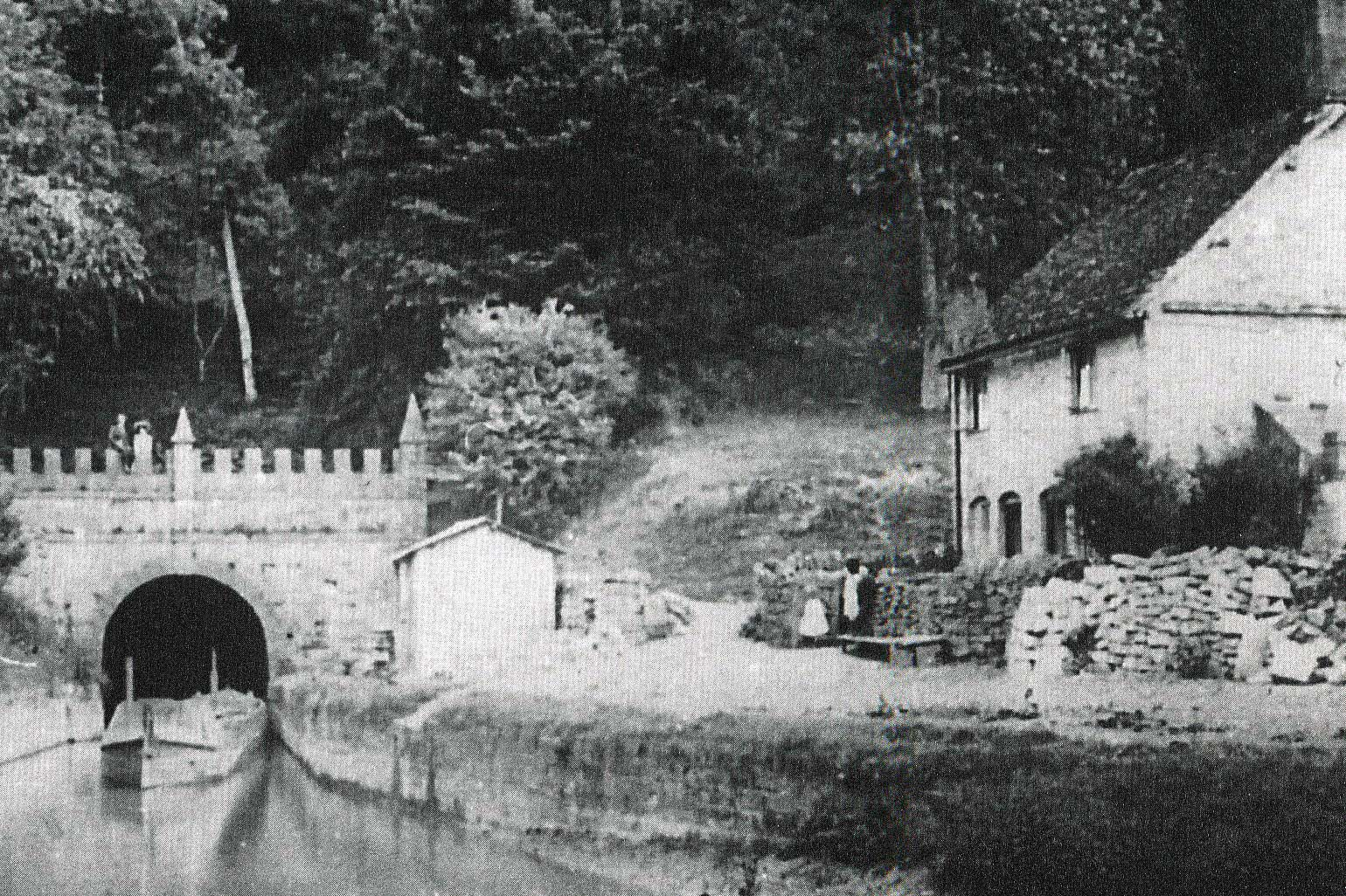 Daneway end of Sapperton Canal Tunnel c.1910. Note the low water level